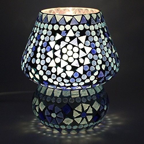 A mosaic lamp in shades of blue and white.