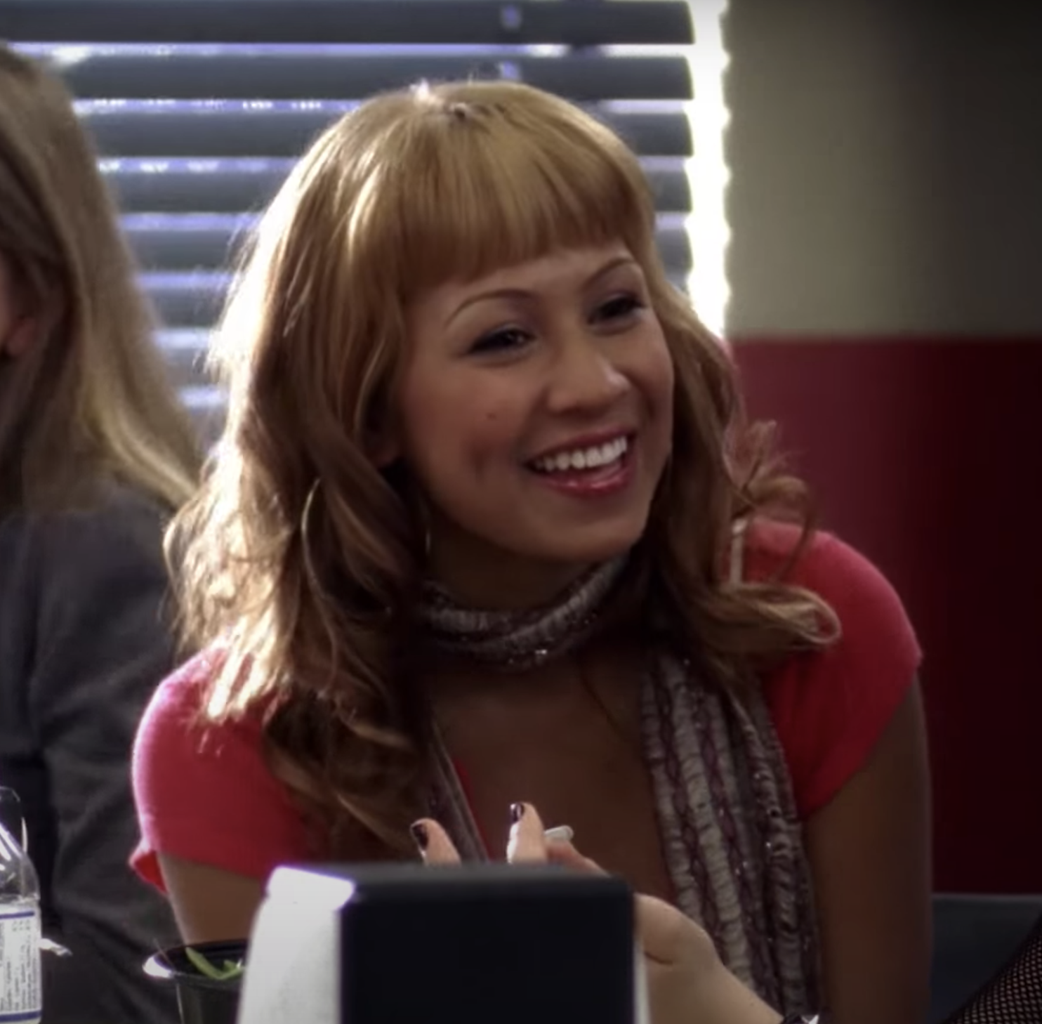 Cassie Steele with orange-tinted blonde hair and bangs
