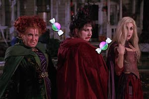 The Sanderson Sisters from Hocus Pocus surrounded by candy emojis