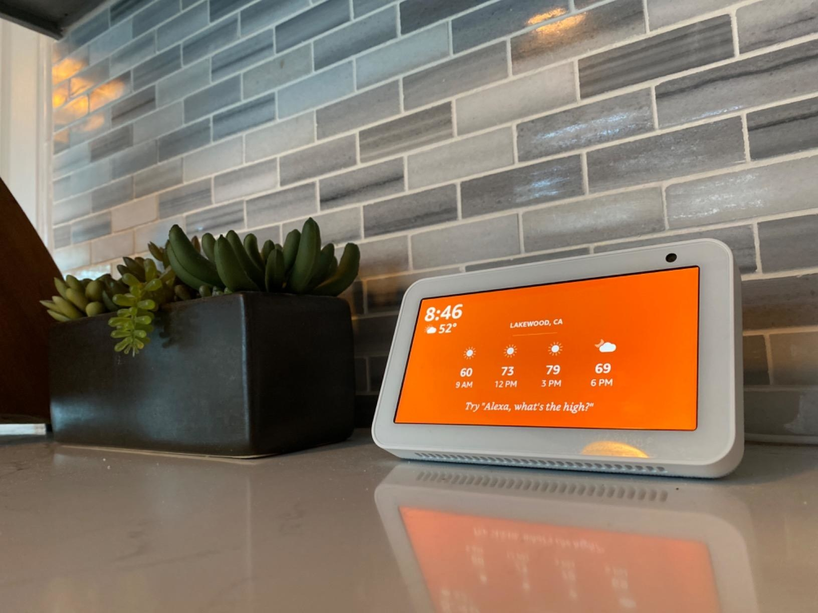 An Amazon Echo Show 5 device displaying the weather