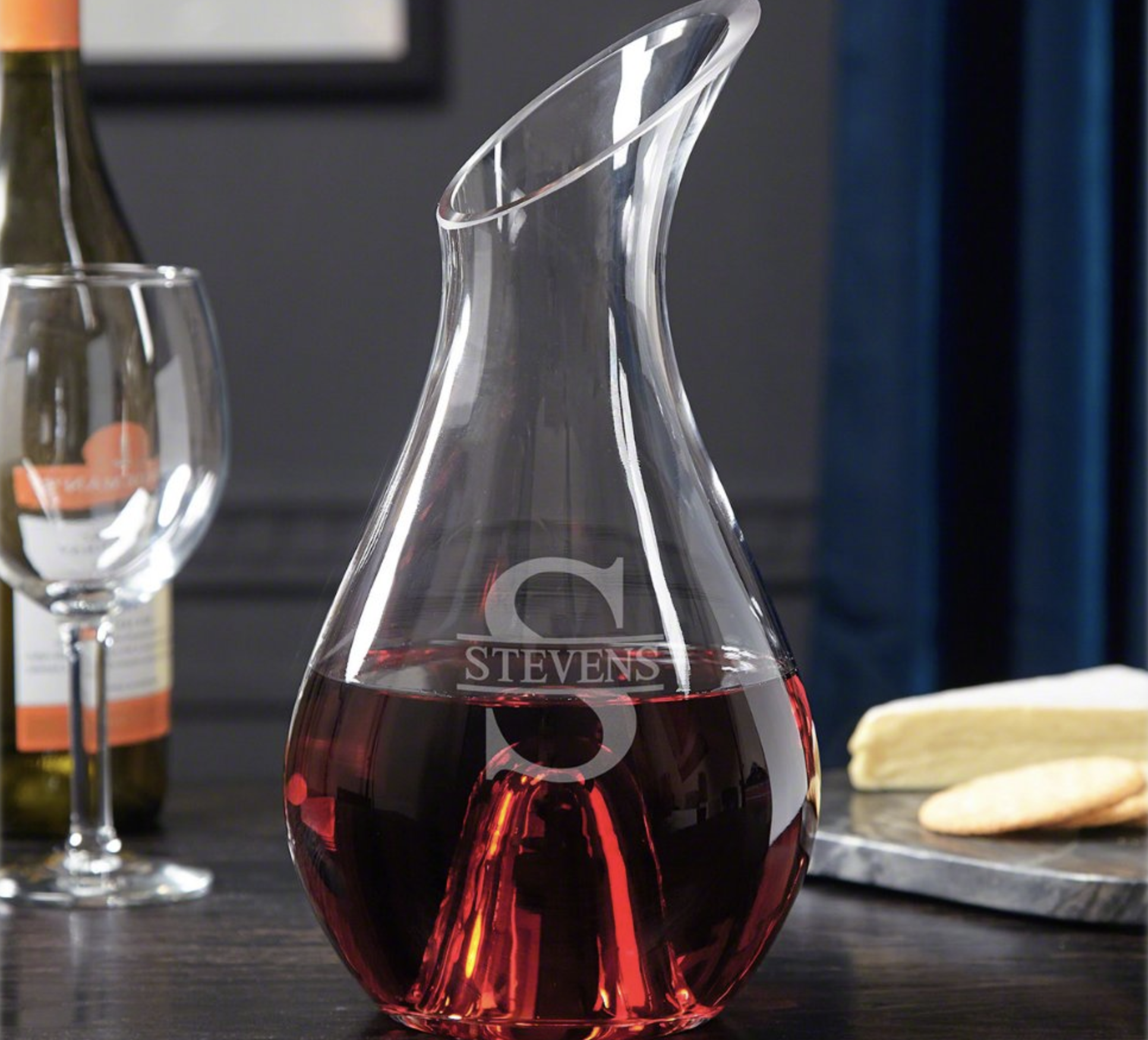 Clear glass wine decanter with angled lid and a monogram etched on it