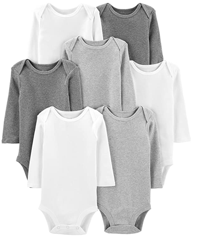 A set of six soft cotton bodysuits laid out on top of each other