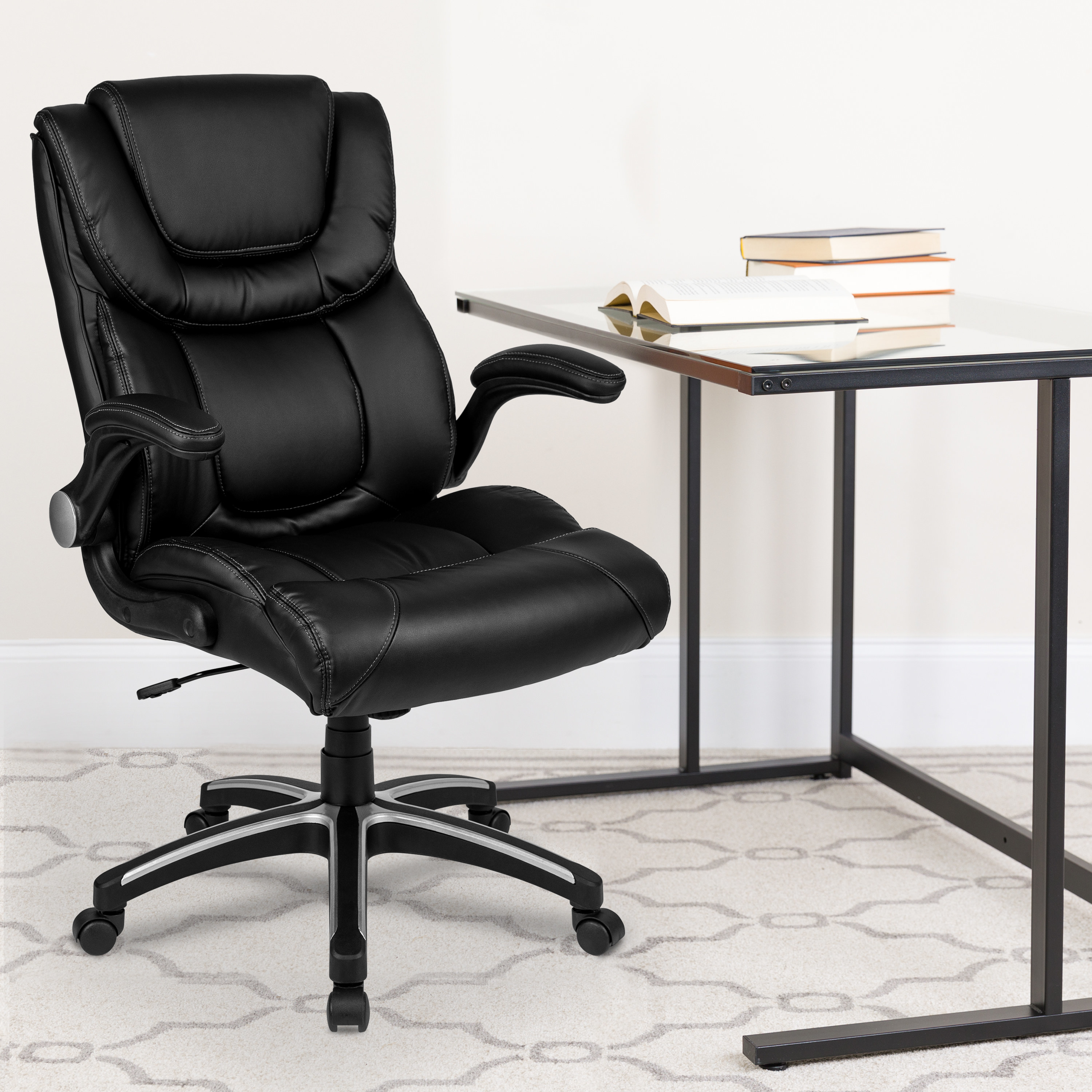 black swivel office chair sitting in front of a desk