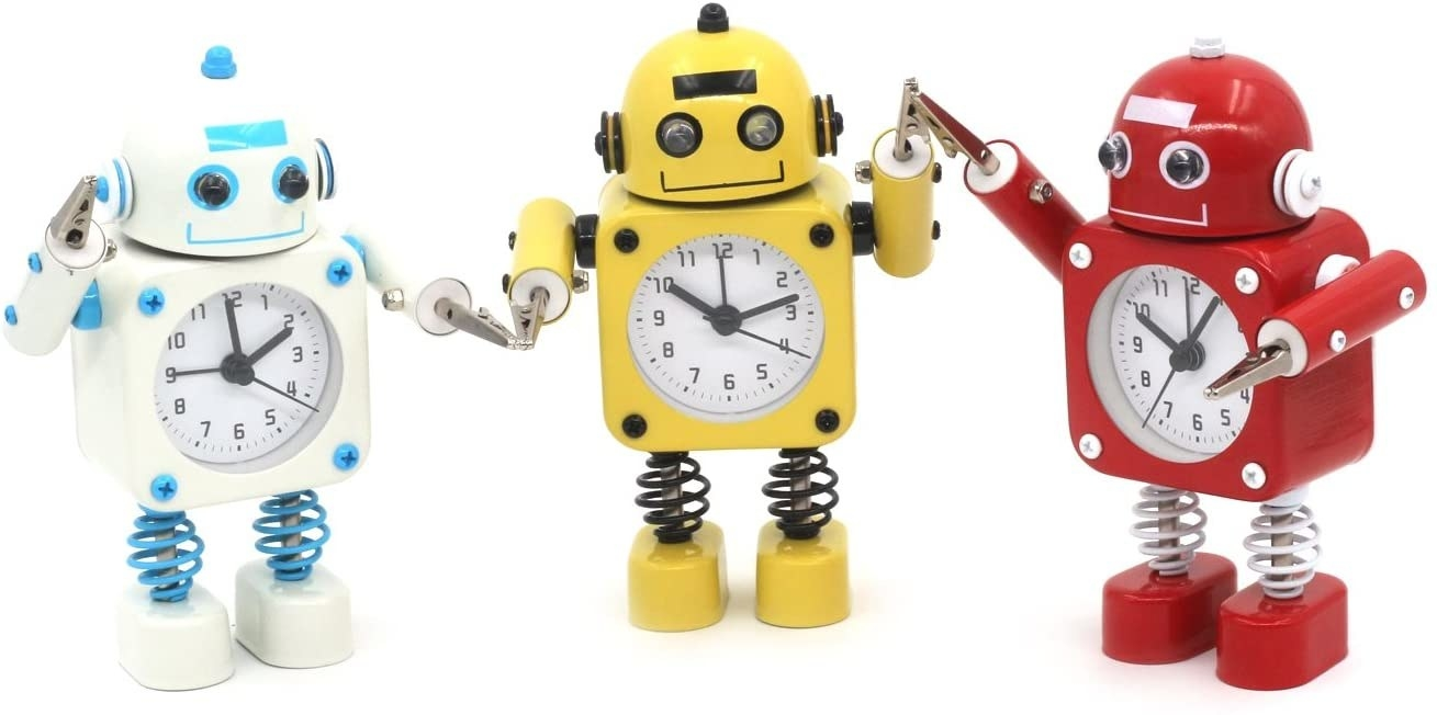 the metal robots with clocks in the middle and clips for hands in white, yellow, and red