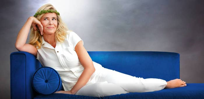 A picture of Chelsea lying sideways on a couch