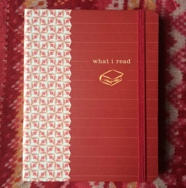 "Small red and white journal with the words ""what i read"" on the cover"