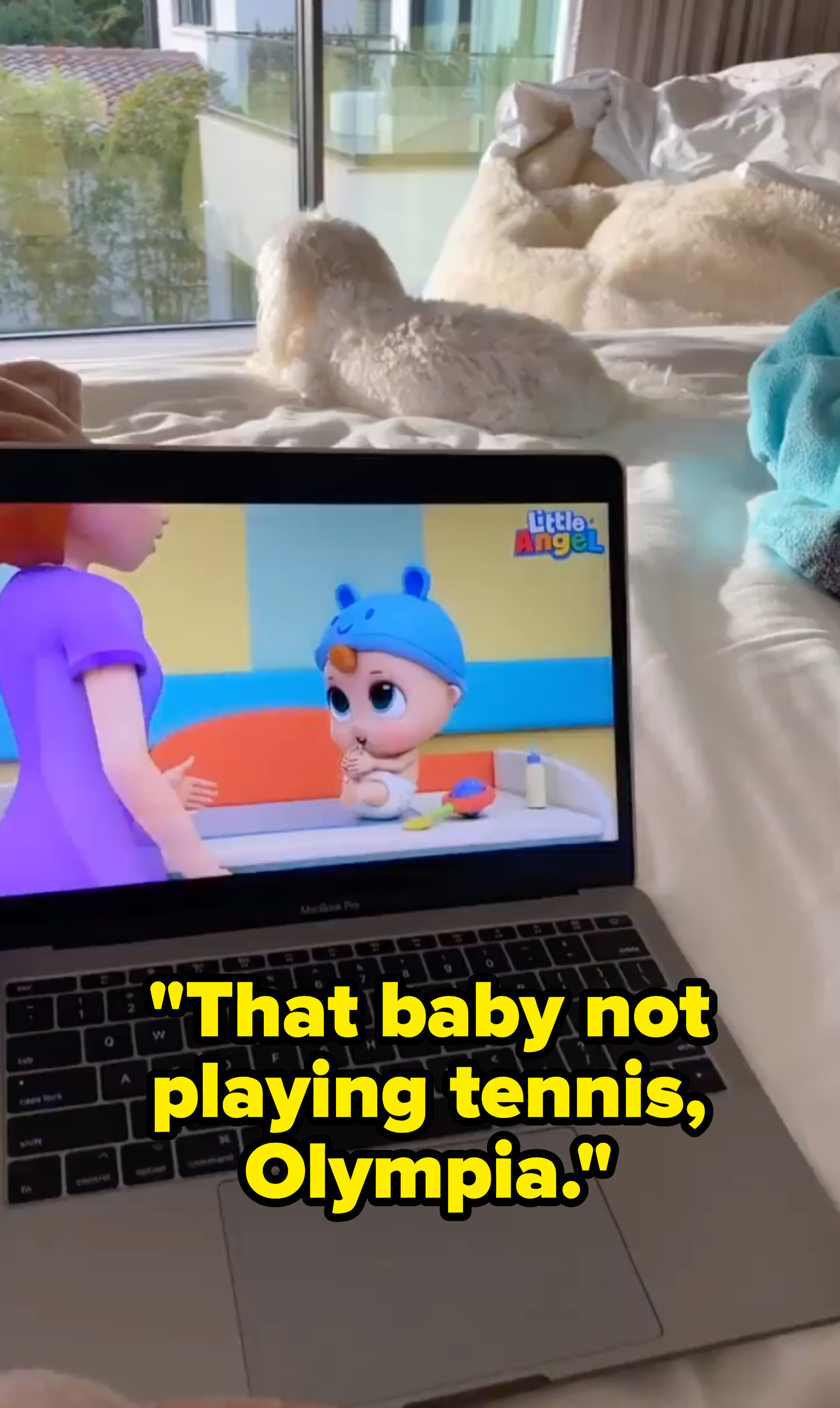 "A picture of Olympia watching Little Angel with the caption ""That baby not playing tennis, Olympia"""