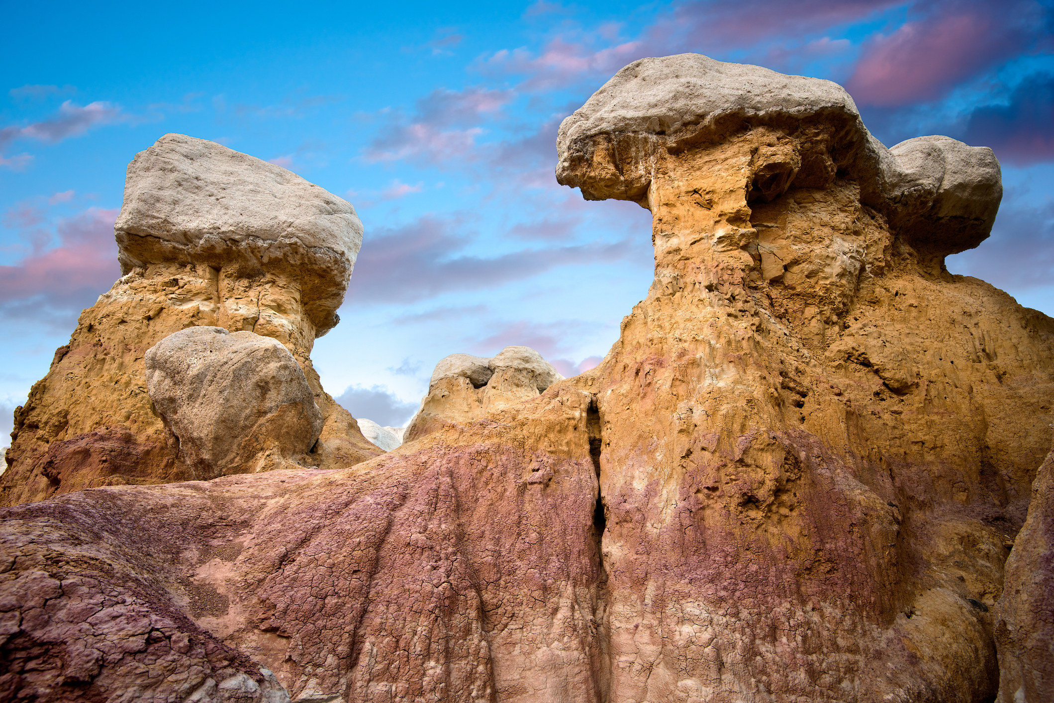 Two sharp rock faces with a purple tinge sit below a twilight sky
