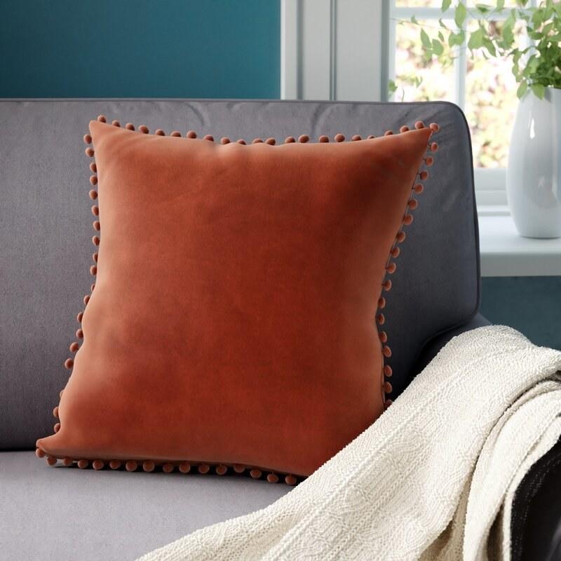Pompom throw pillow in merlot