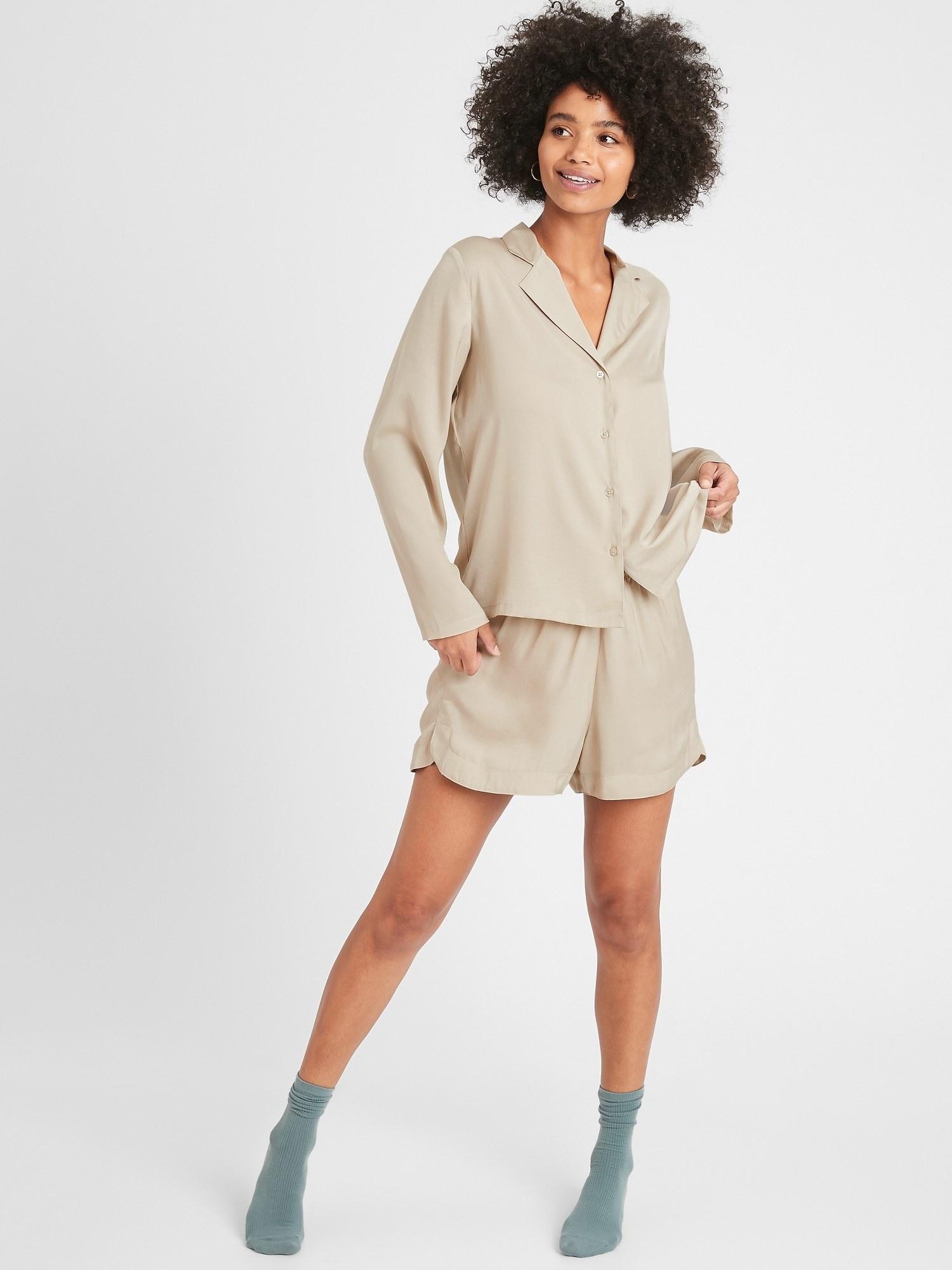 Model in the flowy PJ set in a beige-tan