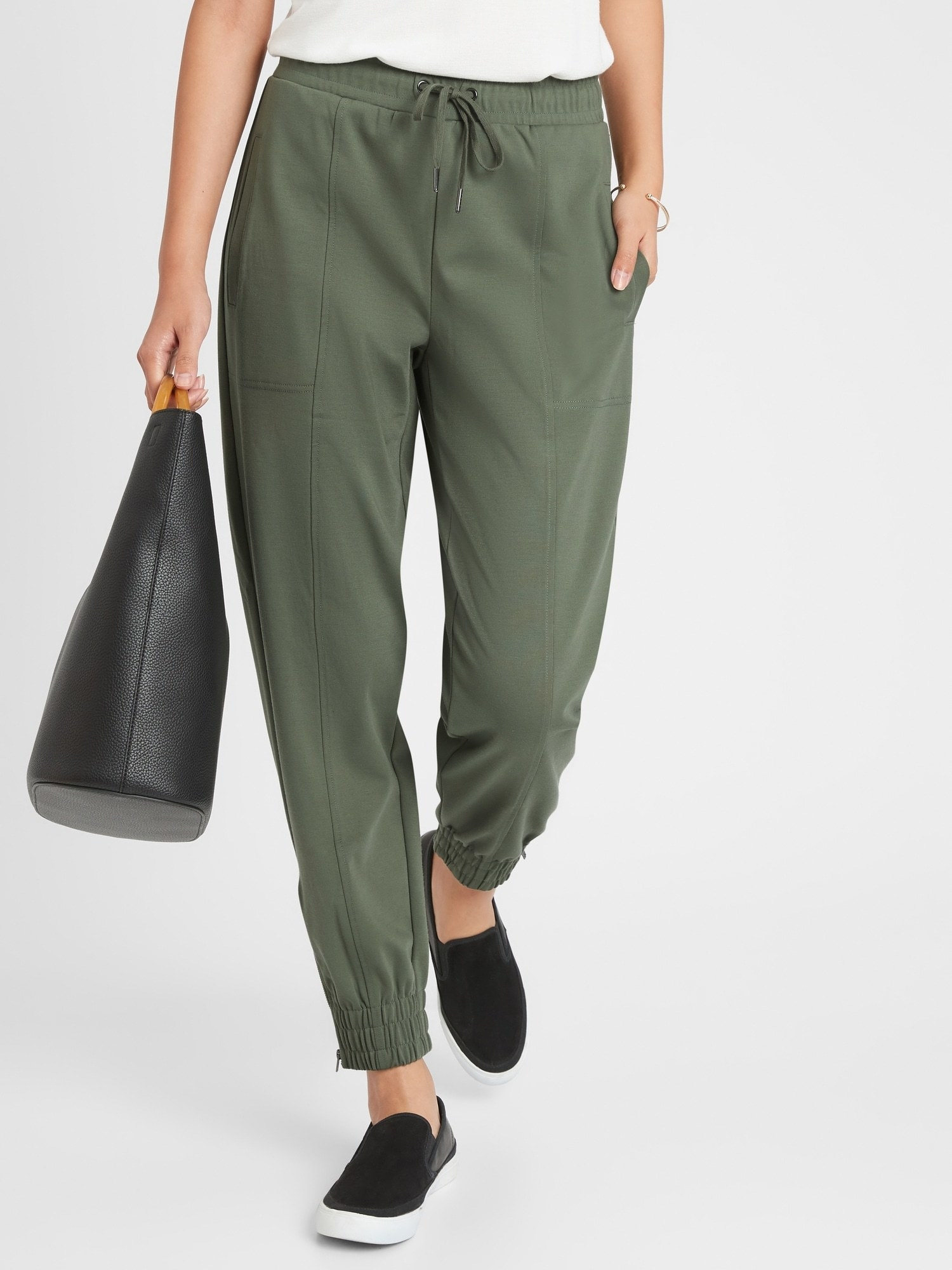 Model in the army green pants