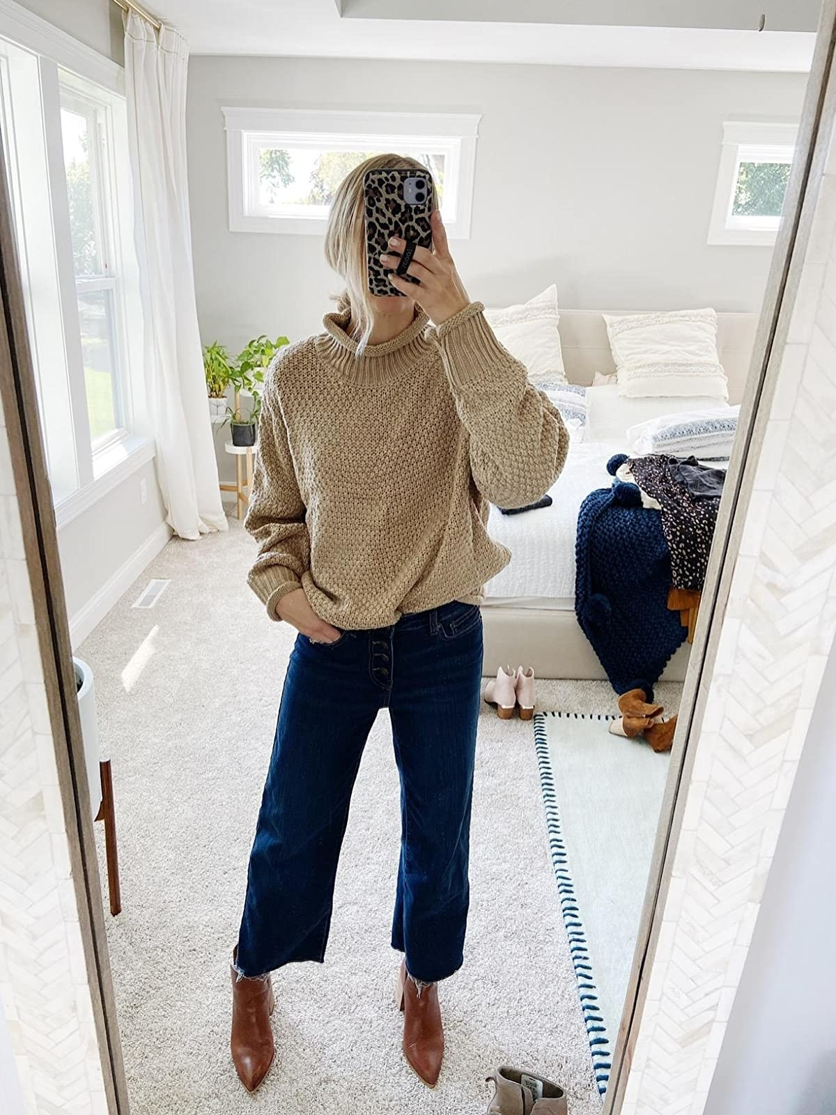 reviewer wearing the cropped wide-leg jeans in dark blue