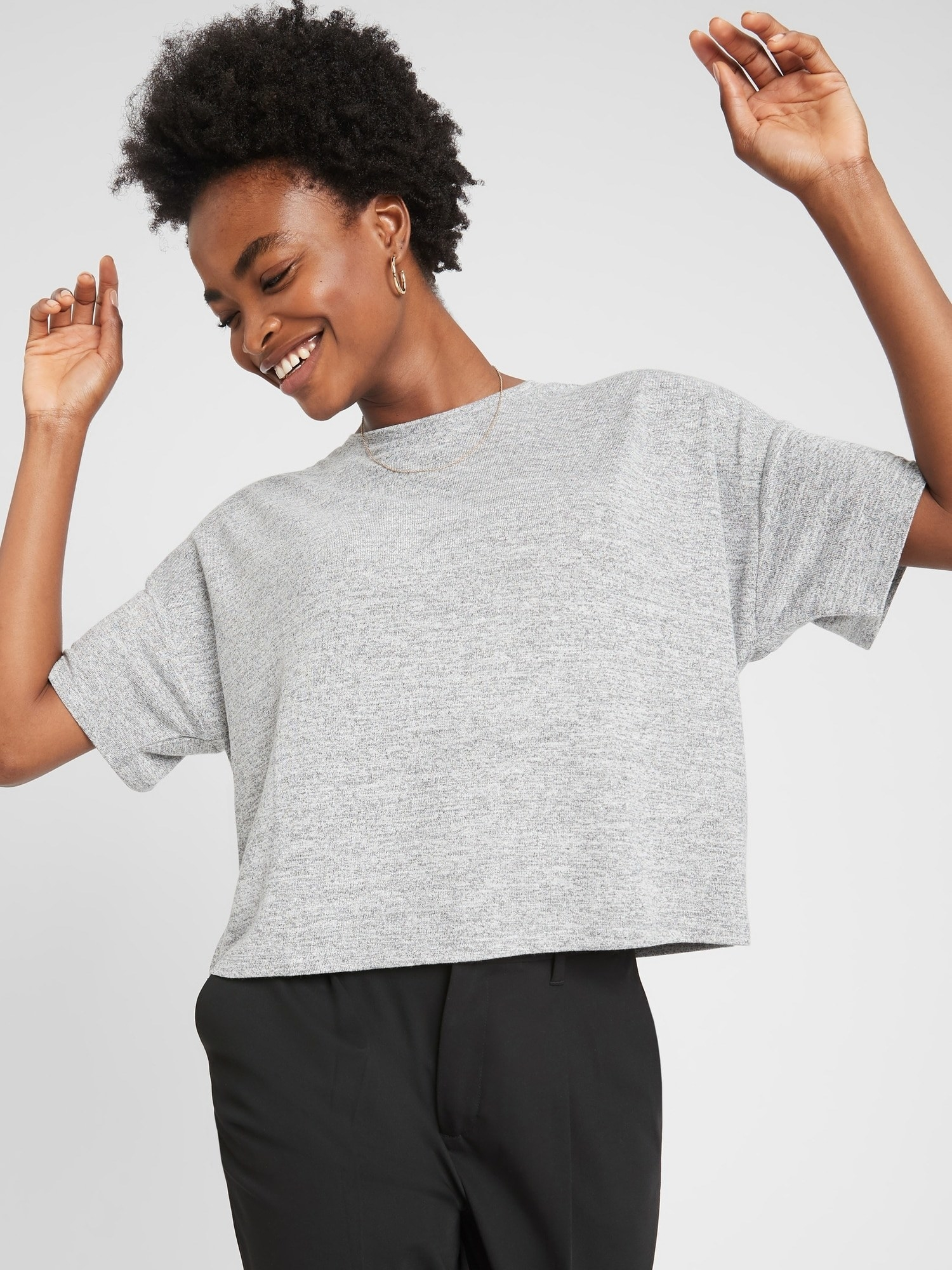 Model in the grey short-sleeve tee