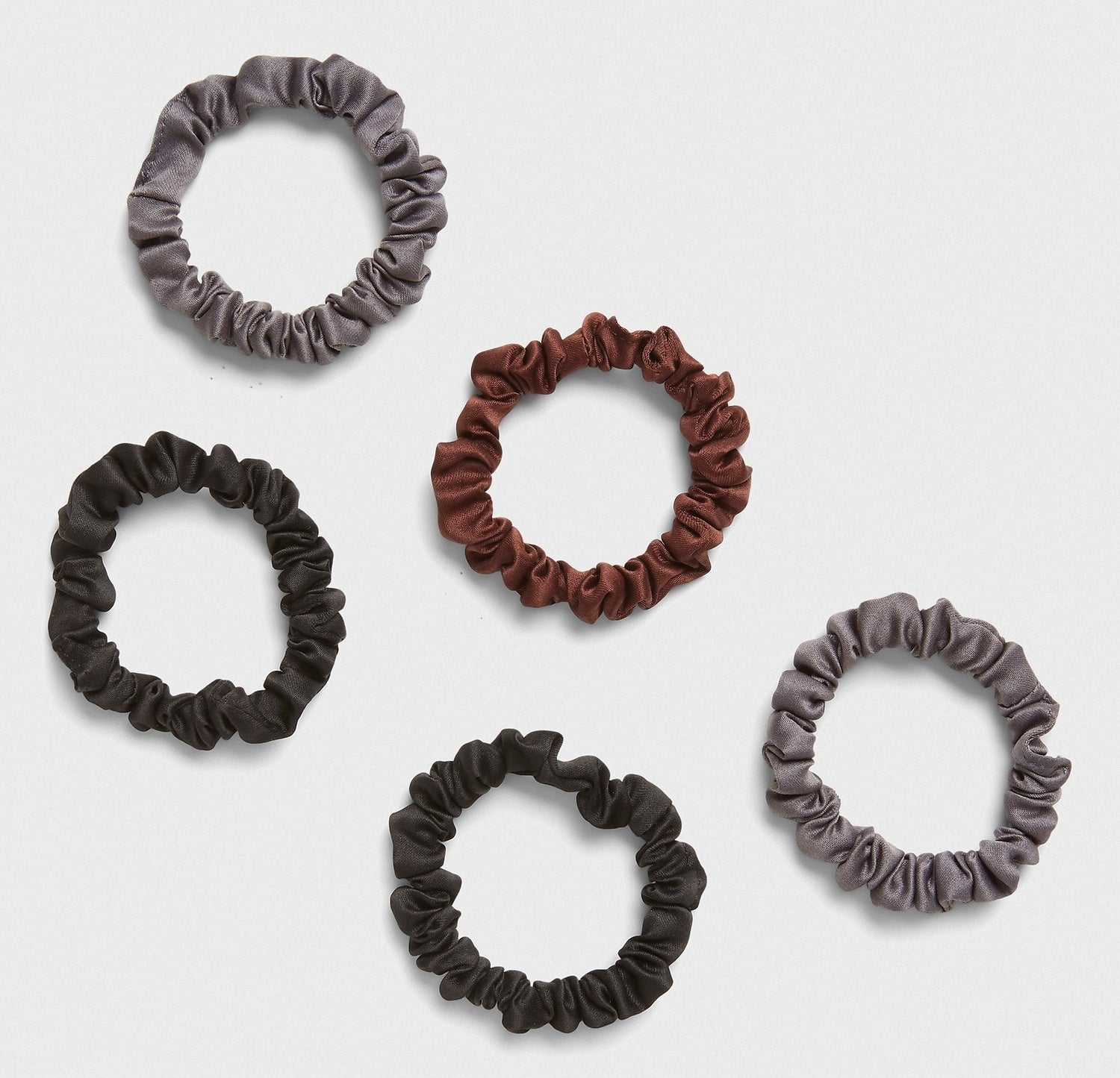 The scrunchies in greys, black, and brown