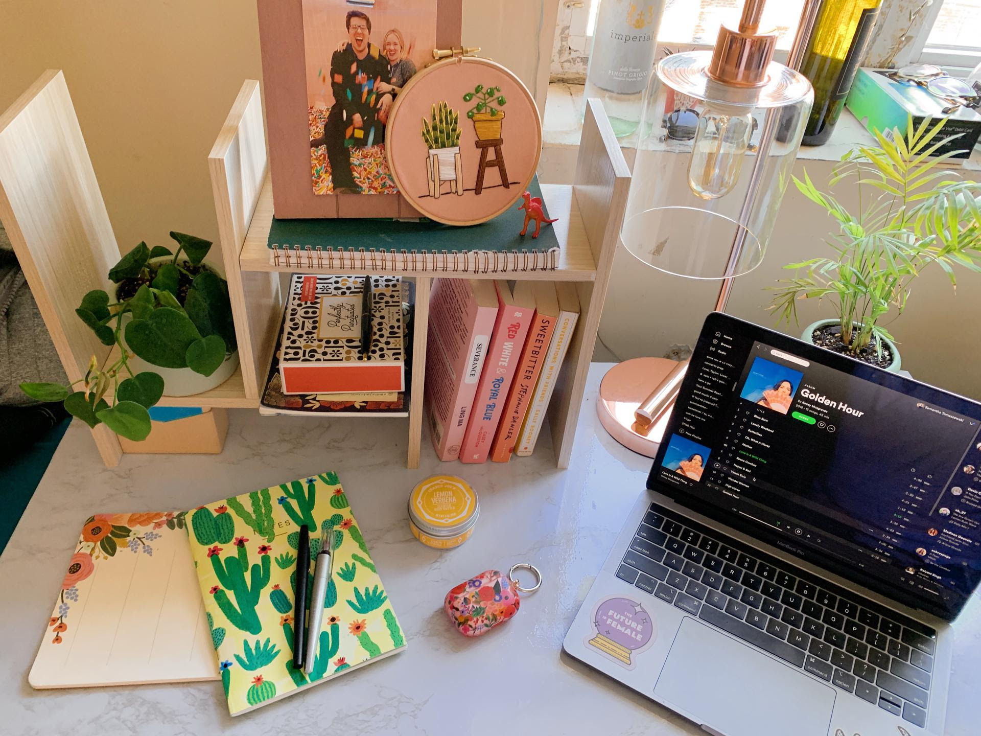buzzfeeder's desk with a spread of colorful accessories and a laptop
