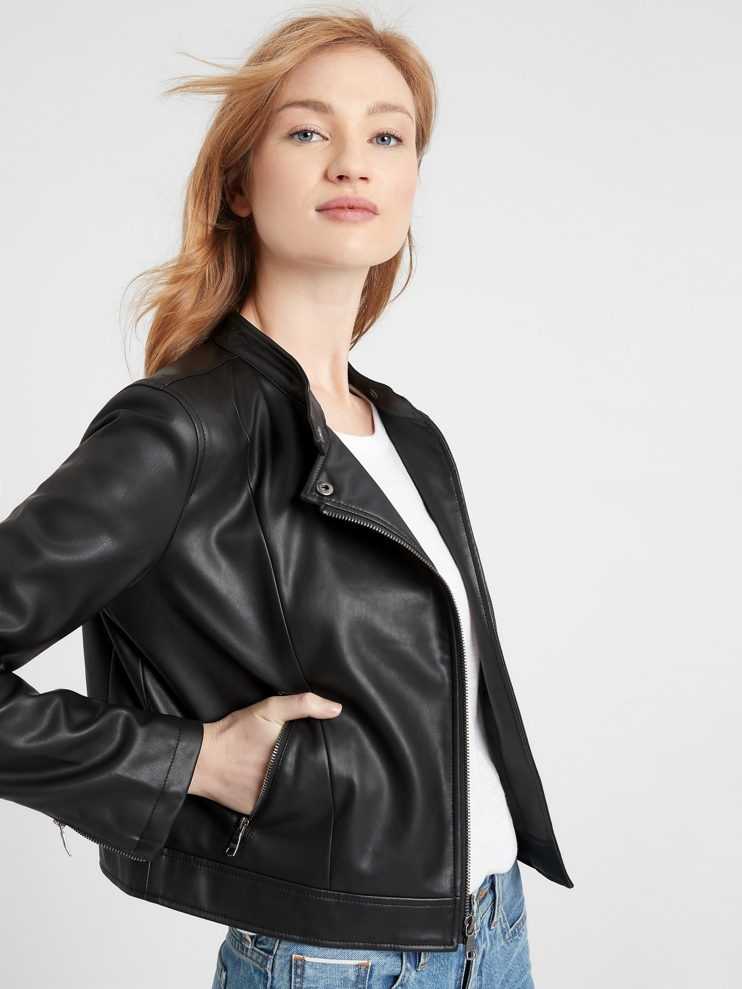 Model in the black leather jacket with minimal hardware and a standing snap collar