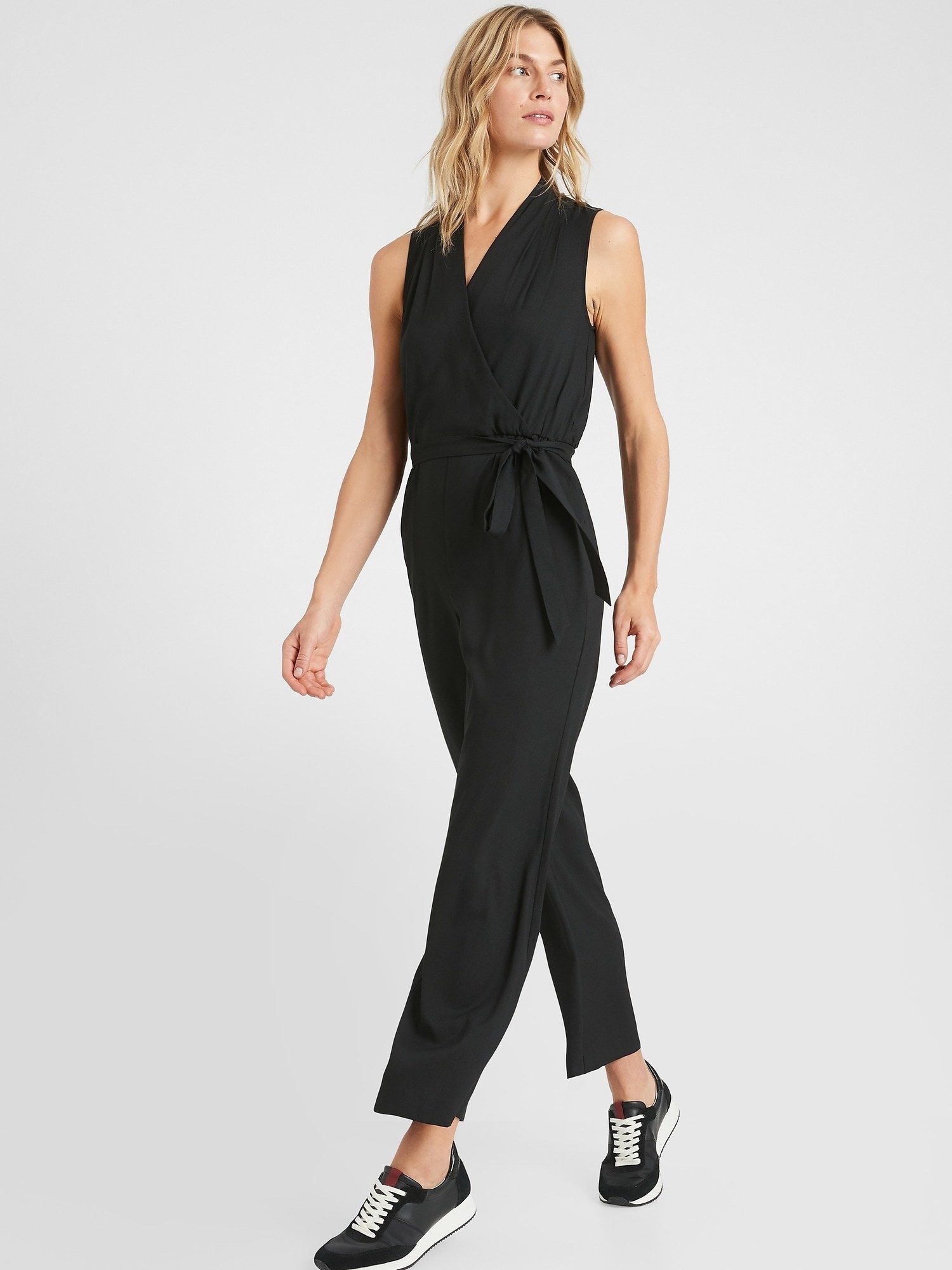 Model in the wrap-style jumpsuit in black