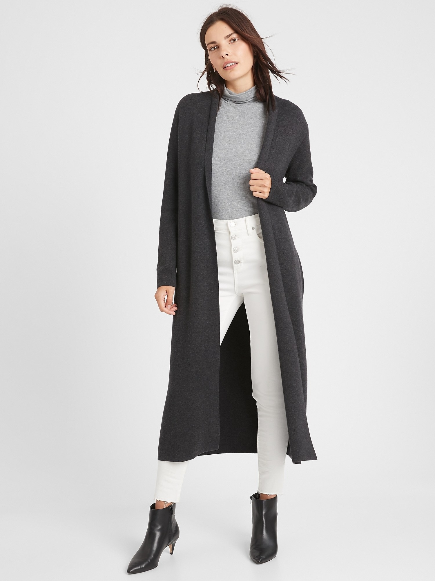 Model in the midi-length grey coat