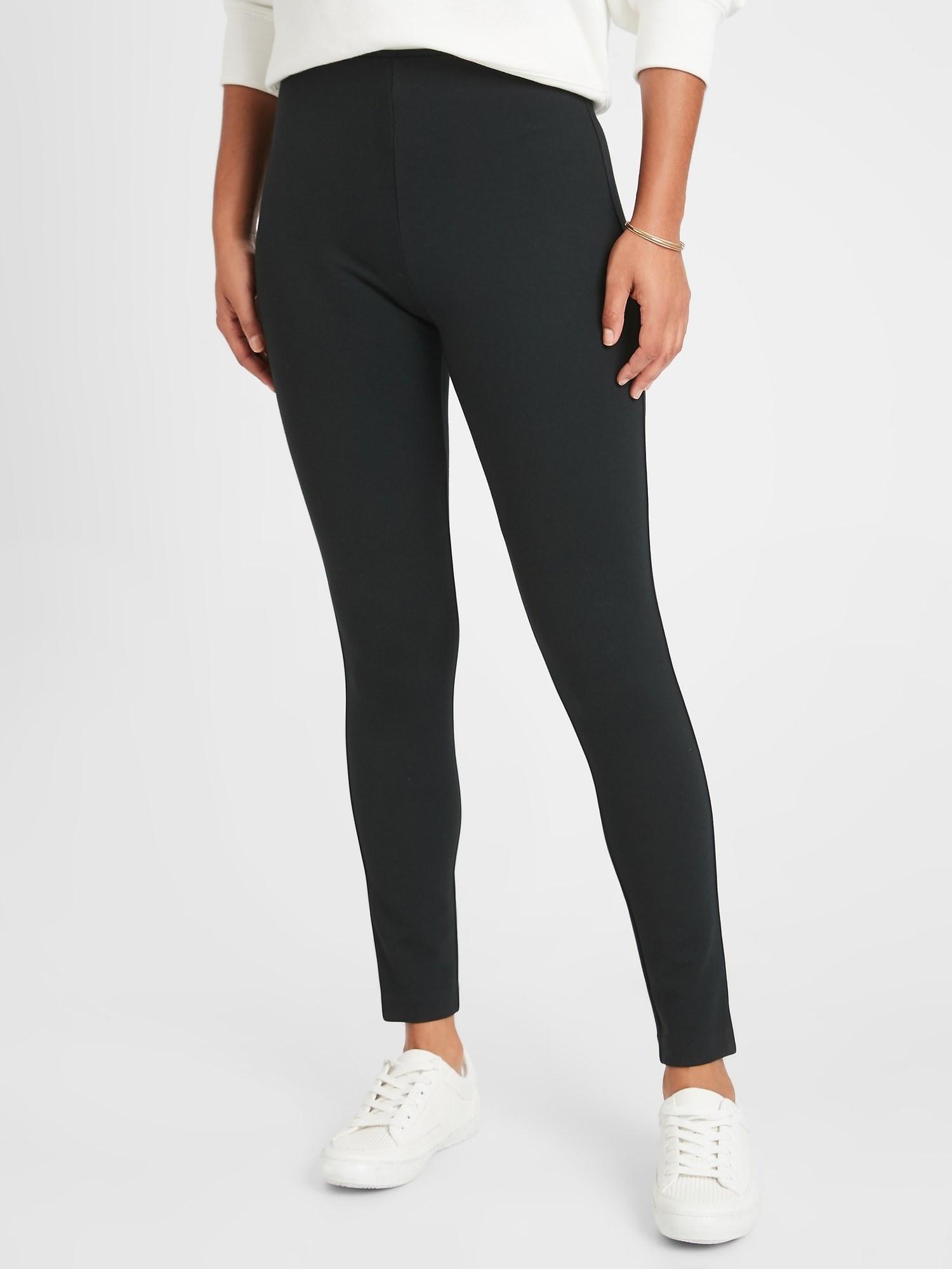 Model in the black high-rise leggings