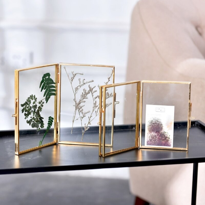 Gold and glass hinged picture frames