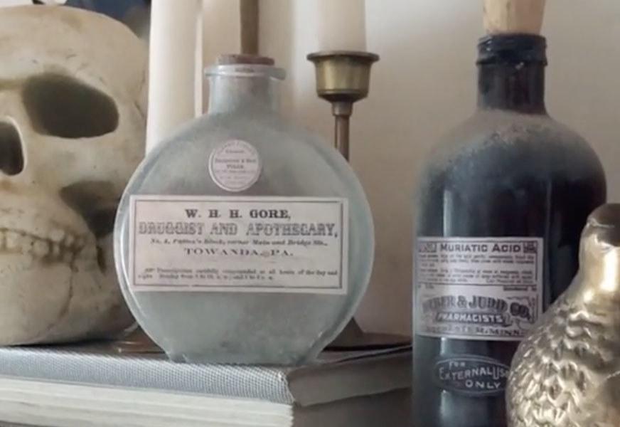Vintage bottle sit on a shelf
