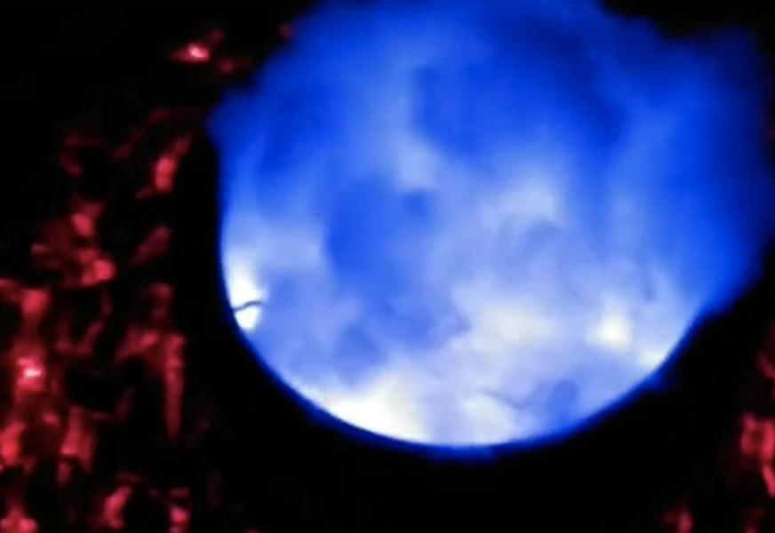 A cauldron glows blue in the dark
