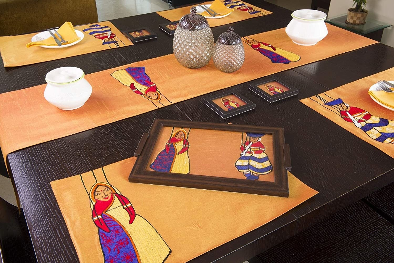 A table set up with the table runner and table mats, coasters, etc. in a similar design.
