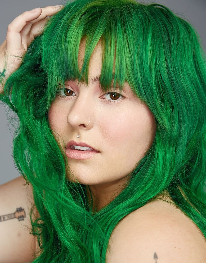 A model with brilliantly green hair after using Kowabunga