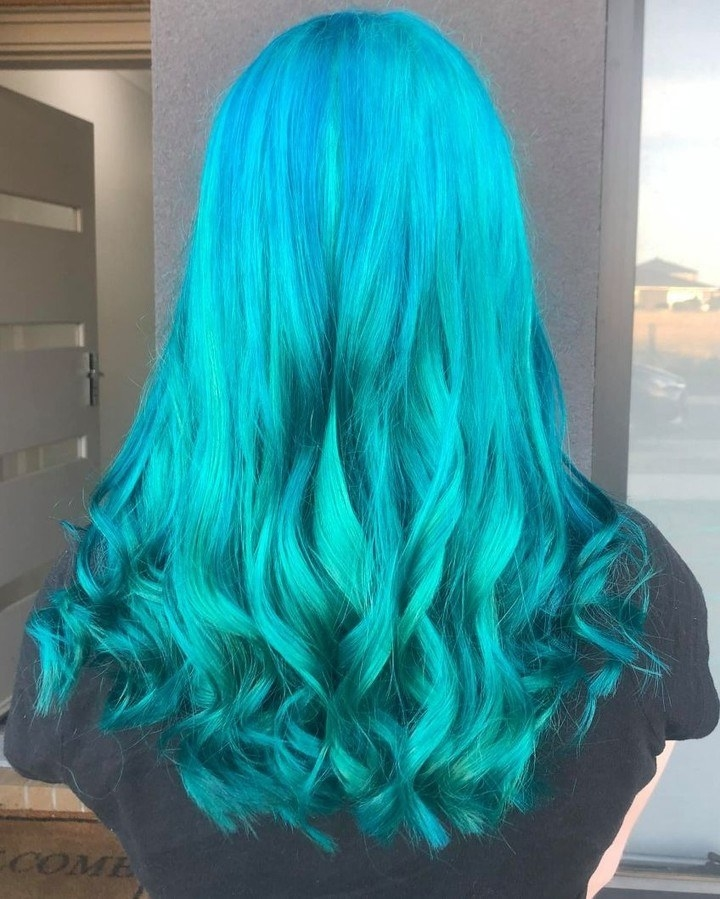 A model's hair curled and blue after using voodoo blue dye