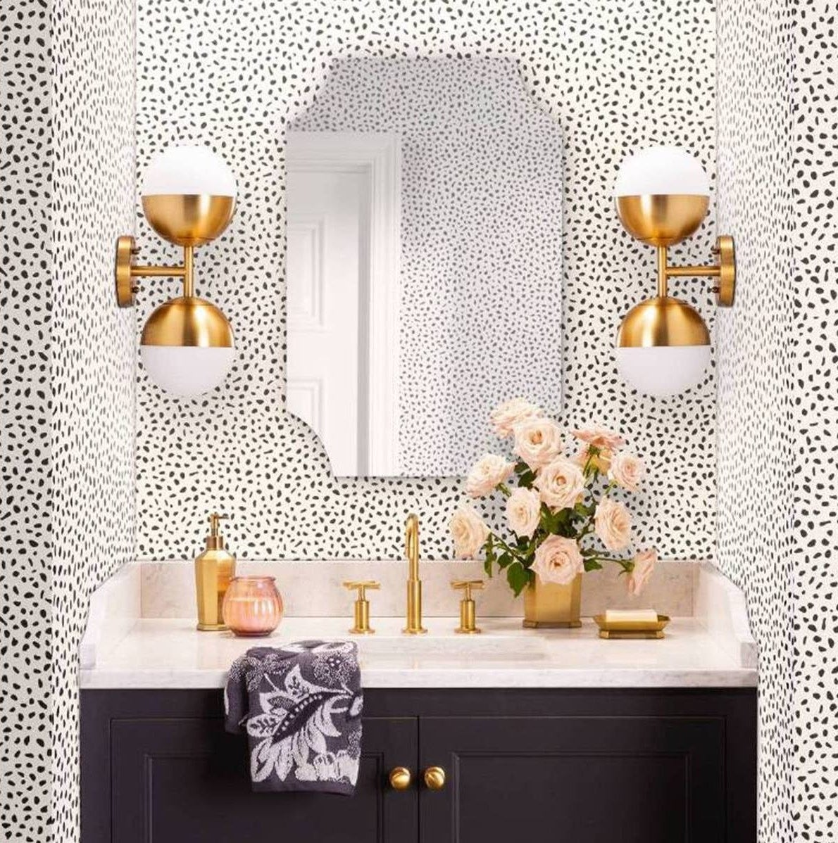 The spotted wallpaper on bathroom walls