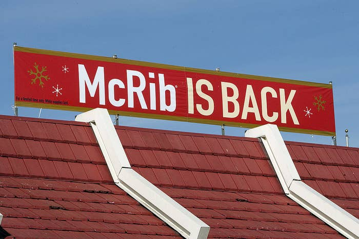 """A McDonald's has a sign that reads """"McRib is back"""""""