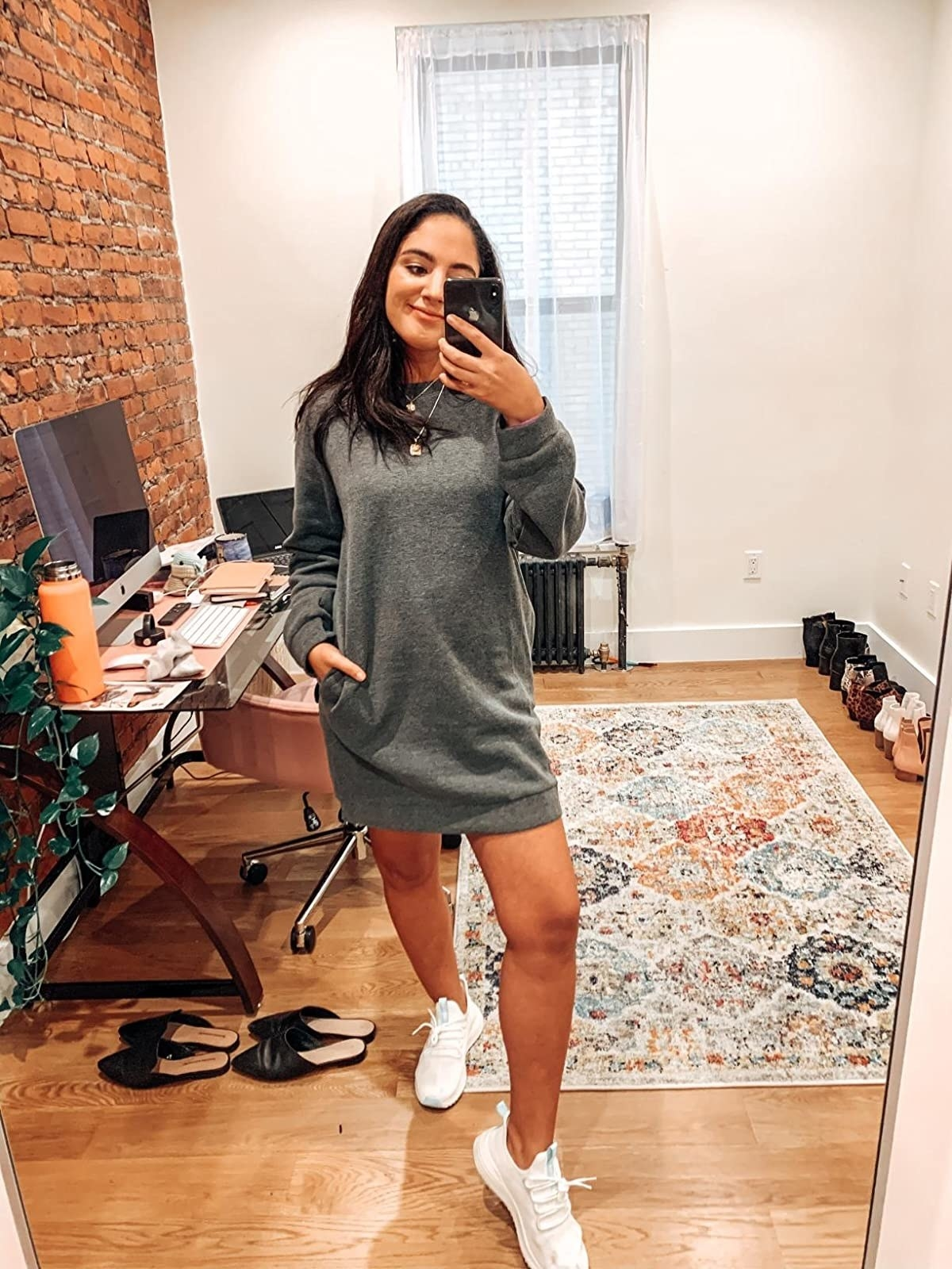 Reviewer in the grey crewneck dress