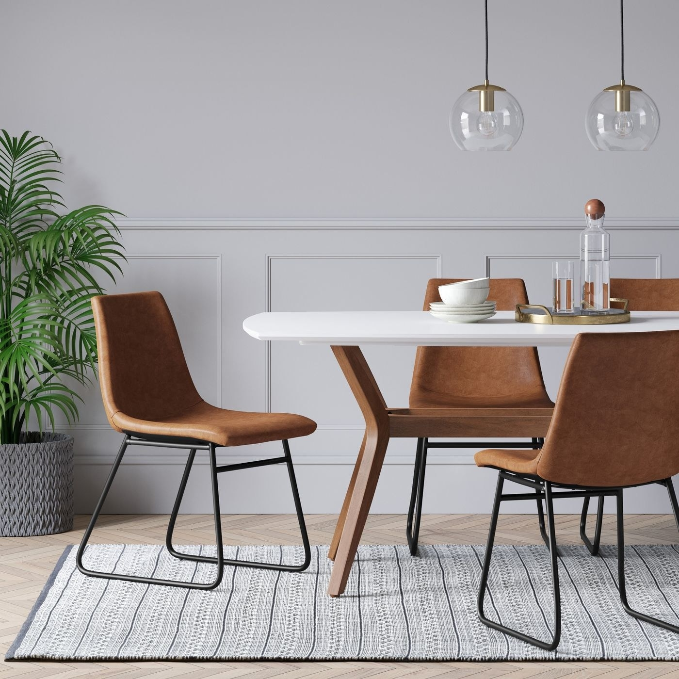 The brown chairs in a dining room