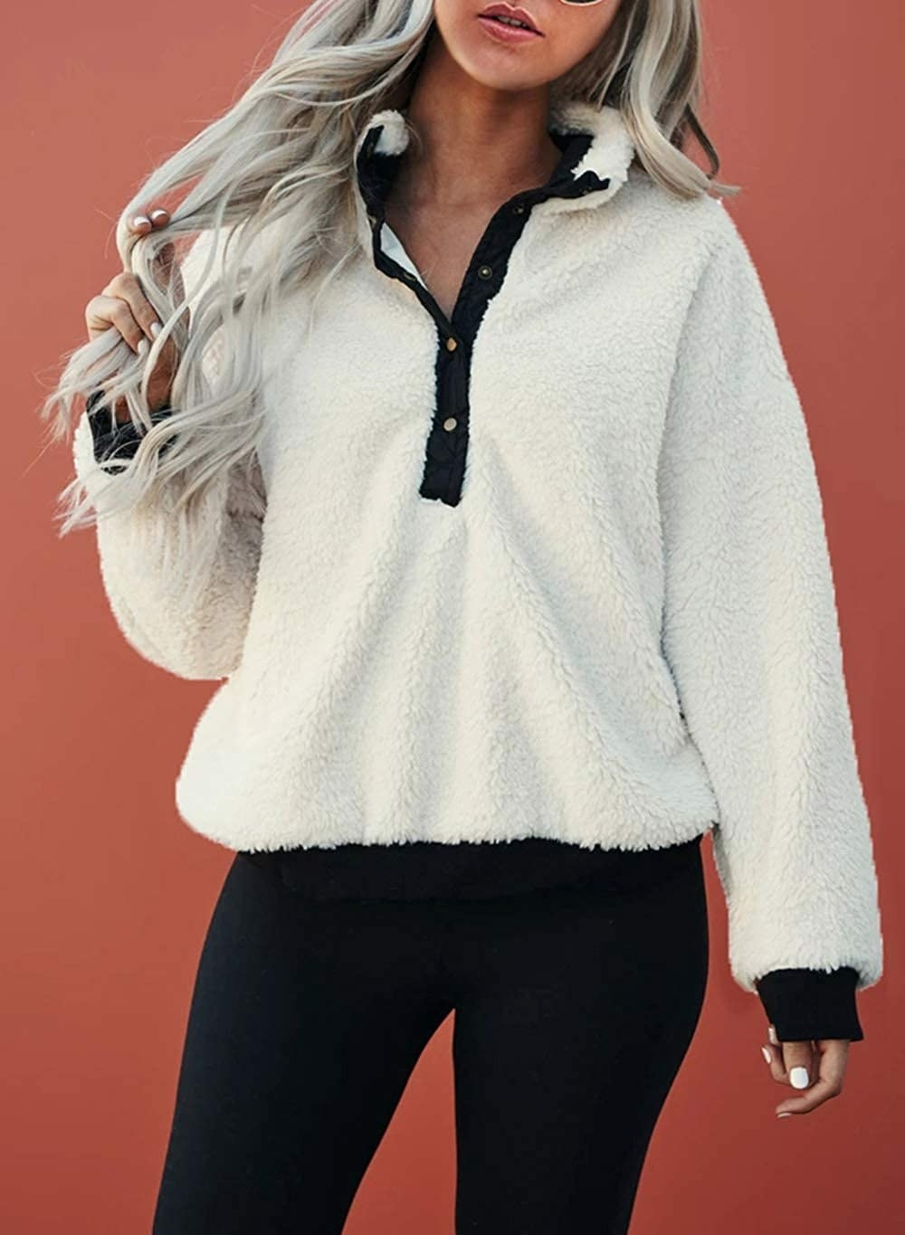 Model in the white pullover with black accents