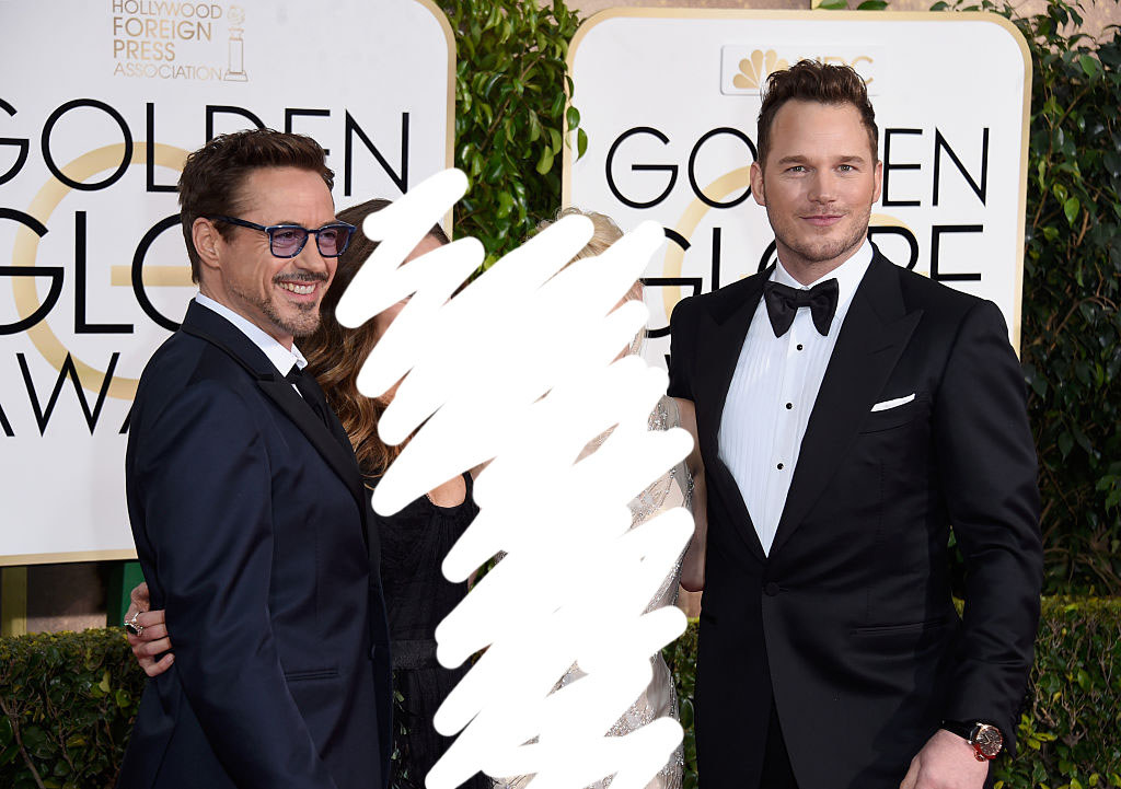 RDJ and Chris on the red carpet with the people in between them badly scribbled out
