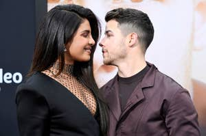 Priyanka Chopra and Nick Jonas at a red carpet, gazing lovingly into each other's eyes