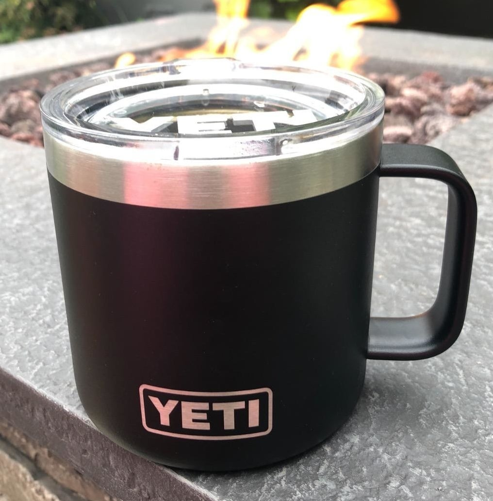 reviewer's black yeti mug with lid and stainless steel interior