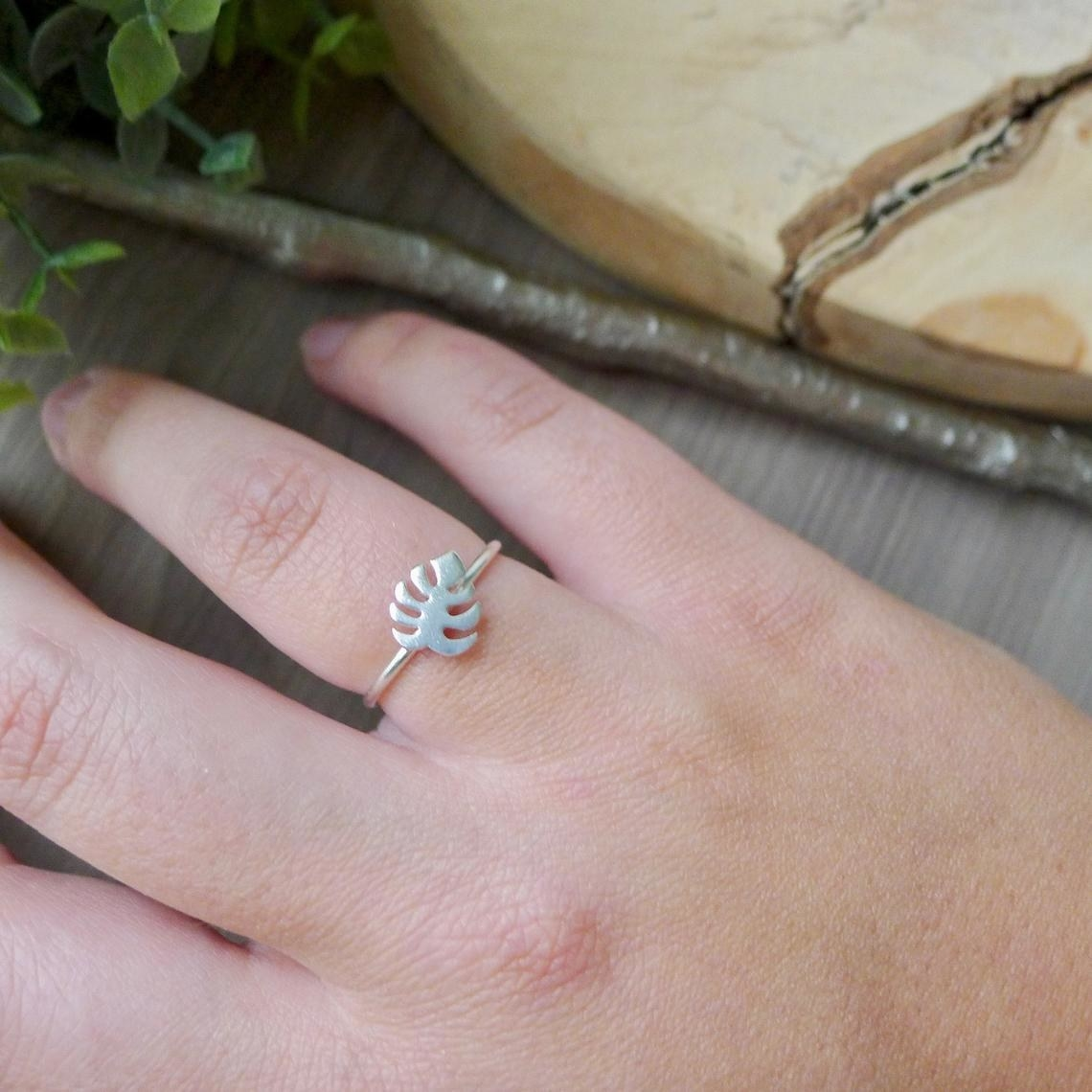 A person wearing the monstera ring