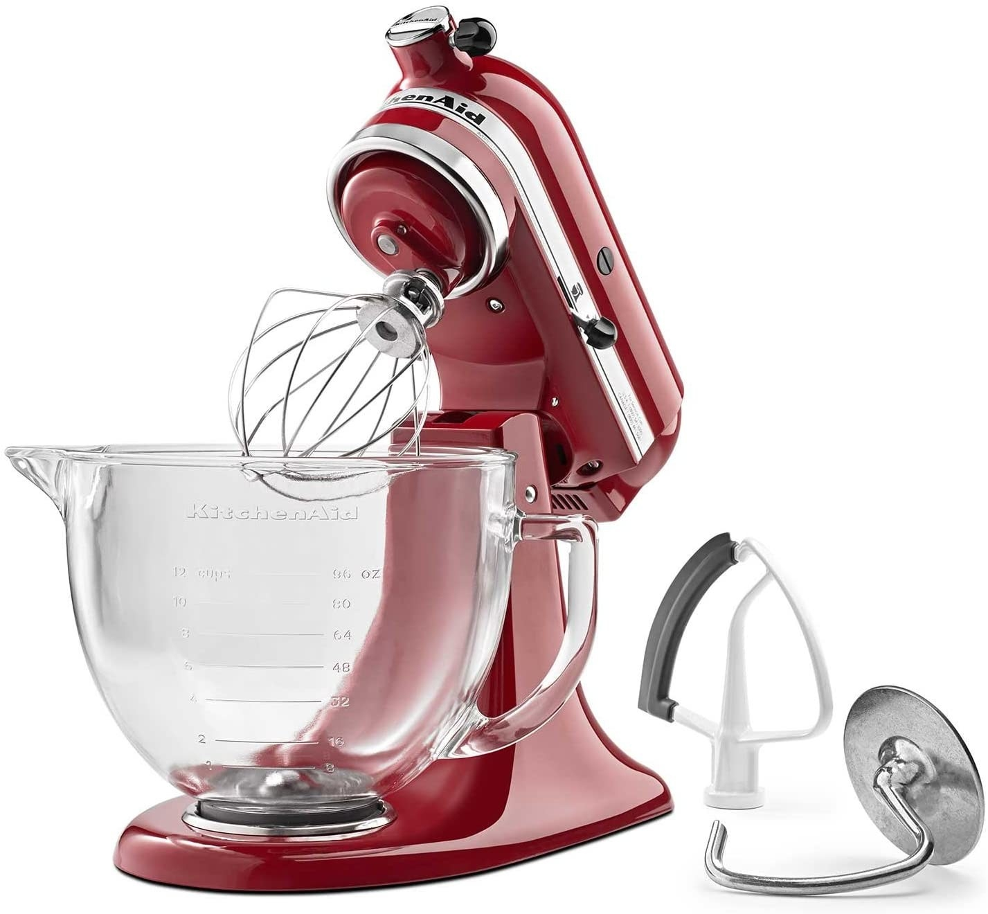 The stand mixer in red with glass mixing bowl and attachments