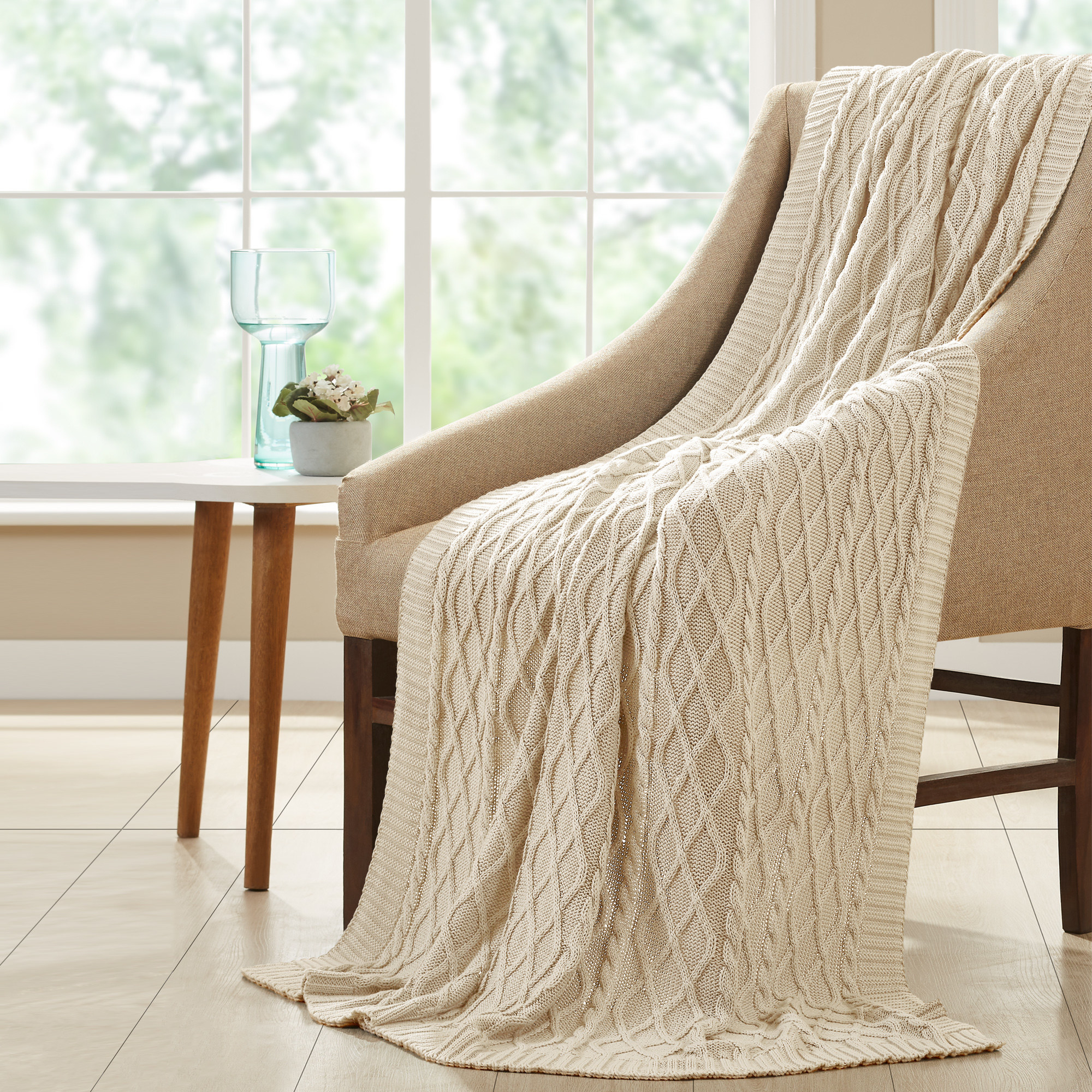 Cable knit throw blanket in sand