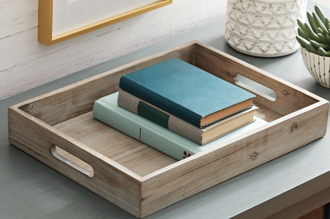 Tabletop tray is used to display books