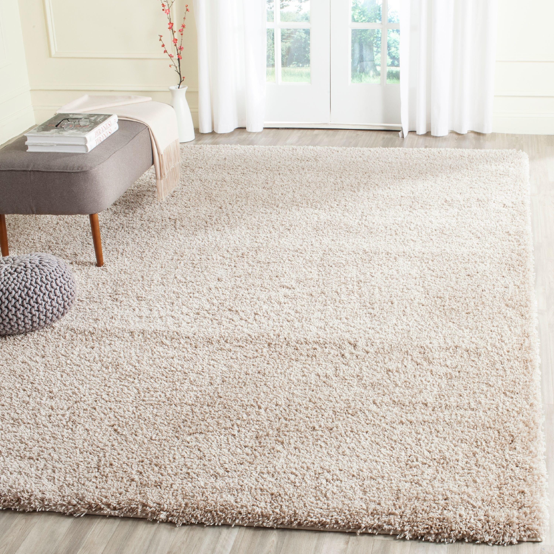 Plush shag area rug in beige