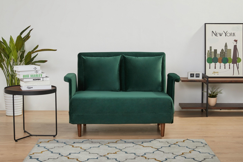 Velvet convertible chair in green