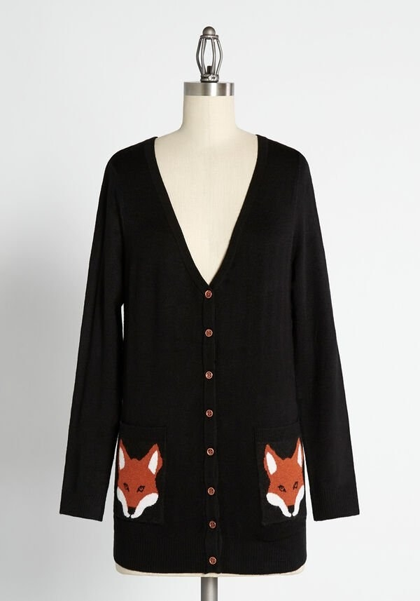 The black fox button-front cardigan on a mannequin