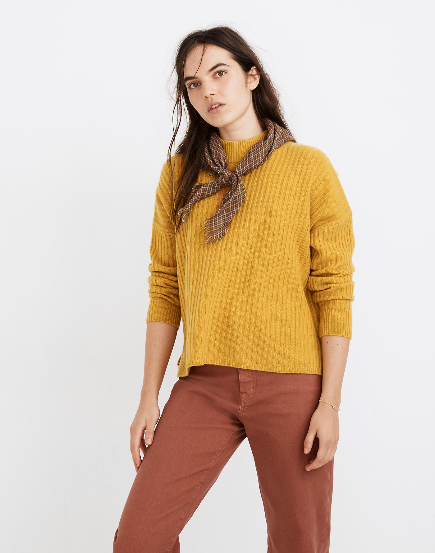 a model in a mustard yellow sweater