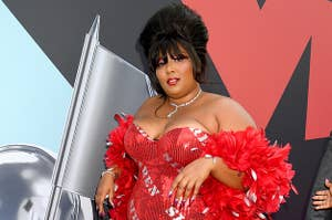 Lizzo wearing a puffy hairstyle at an event