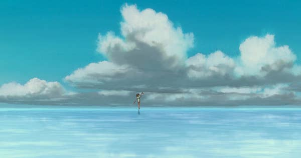 A girl walking on shallow water with large clouds above her