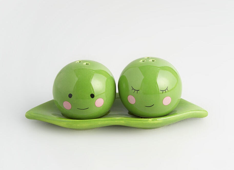 The pea pod plate with circular peas with faces on them and holes on top