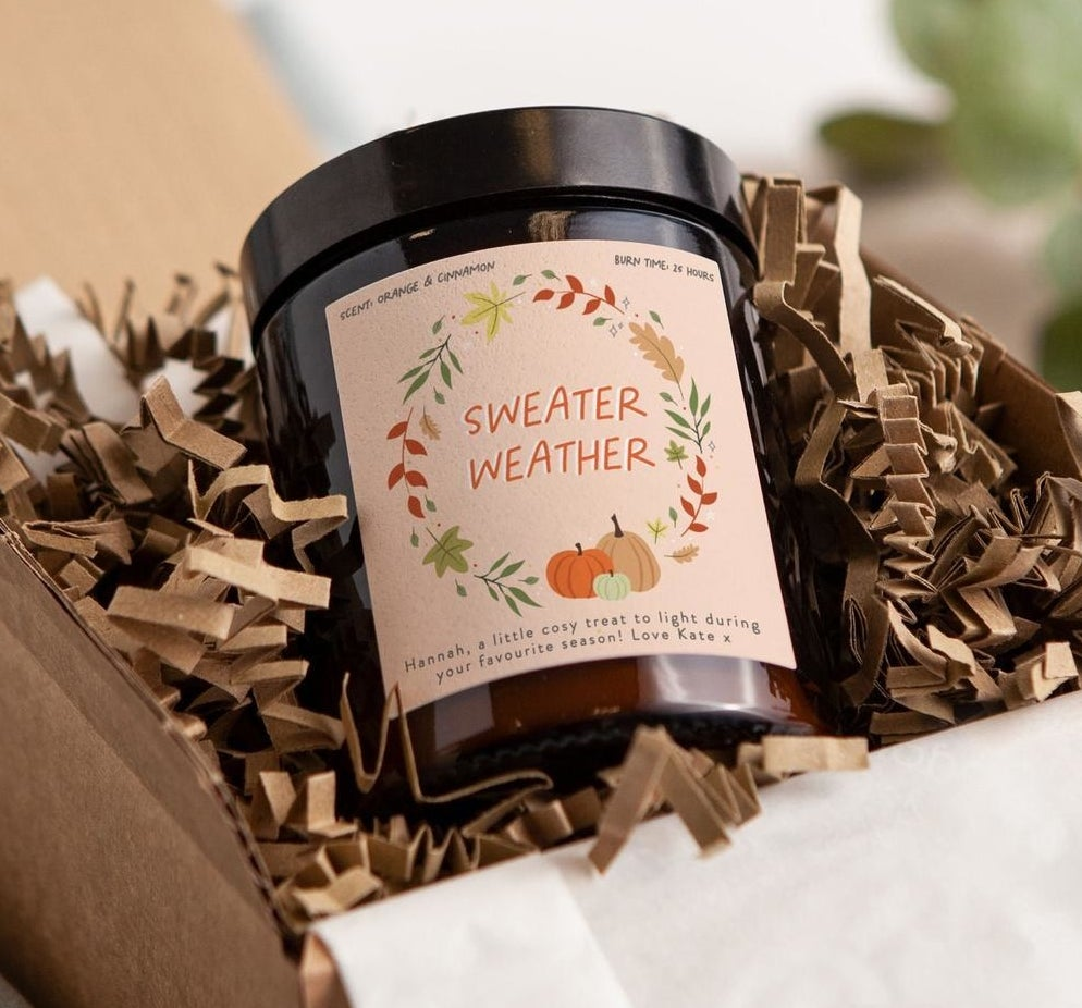 The sweater weather candle in a box