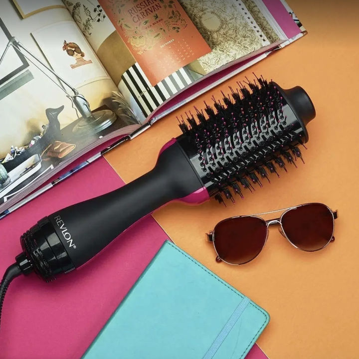 The dryer and volumizer that looks like a round hair brush with a cord coming out of the end